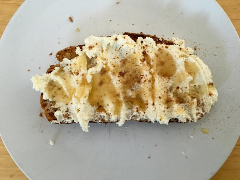 Eating toast with (homemade) ricotta and honey.