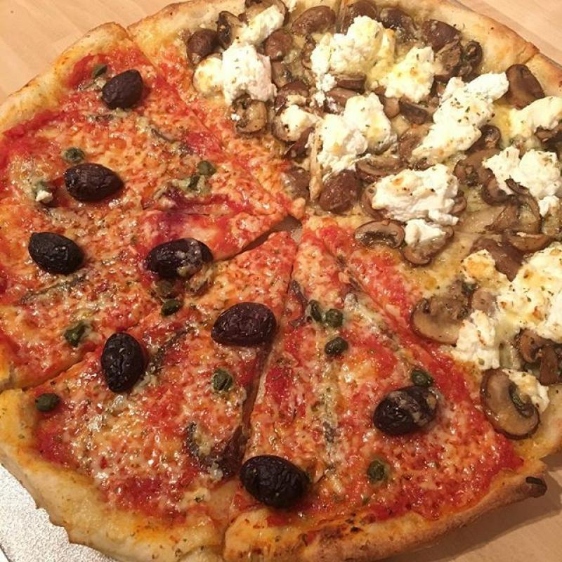 Pizza: one half Napoli (anchovies, olives, capers, tomato and cheese), the other half mushroom and ricotta.