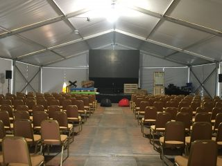 Looks like I'm going to be speaking in an honest-to-goodness tent. Time to preach it, revival style.