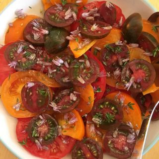 Sussex tomatoes with thyme and chive flowers from the garden.