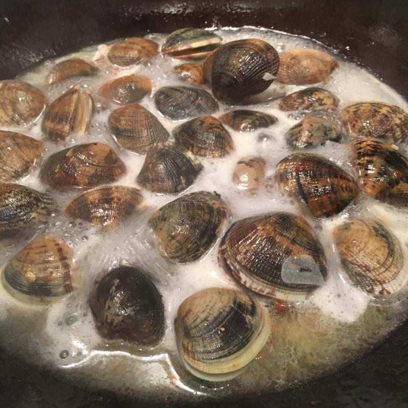 Cooking clams.