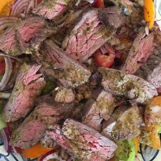 Flatiron steak with toasted spice vinaigrette.