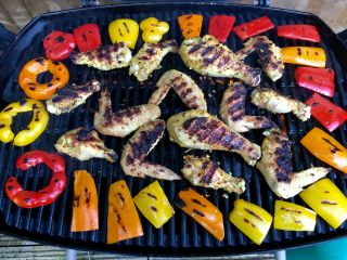 Grilling chicken and peppers.
