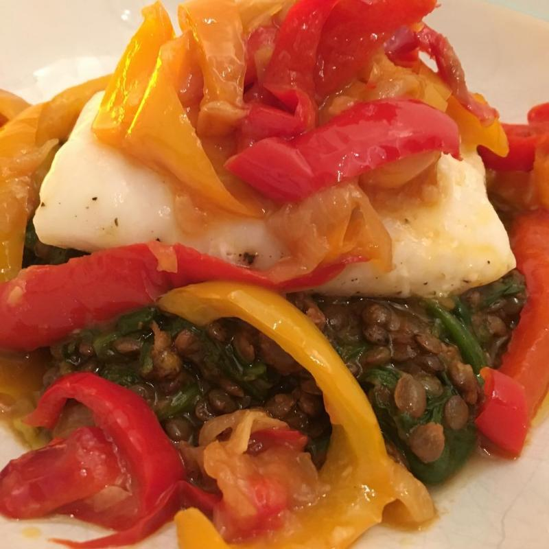 Sous-vide cod with peppers on lentils.