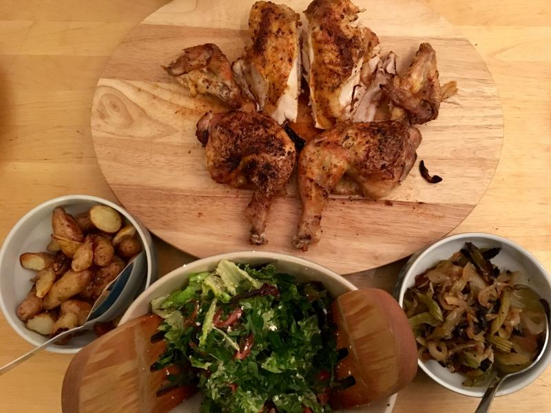 The roast chicken angel watches over its flock of side dishes.