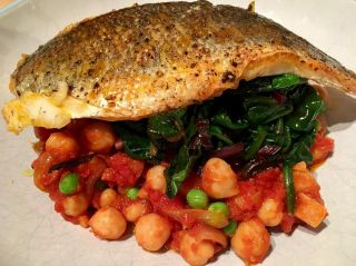 Seabass on spinach on chickpeas and chorizo.