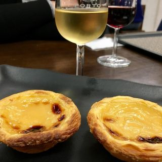 Port and pastel de nata.
