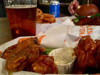 Checked in at The Joker. Wing night! — with Jessica