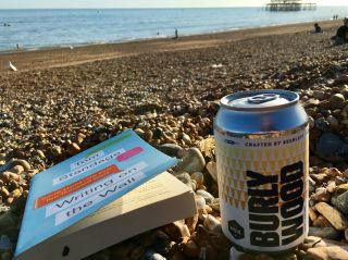 On the beach with a book and a beer.