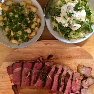 Rib of beef with potatoes and broad bean, fennel and burrata.