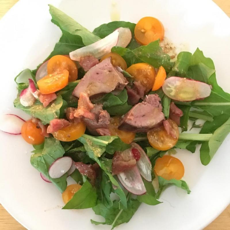 Chicken liver salad with leaves and radishes from the garden.
