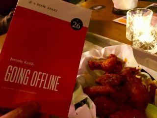 Colour-coordinating my hot wings and my book.