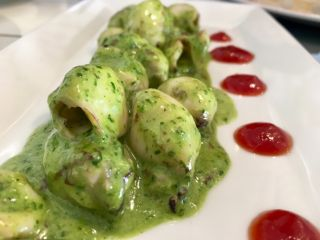 Checked in at Coquille. Baby calamari in parsley pesto — with Jessica