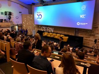 Checked in at CERN Main Auditorium. Waiting for the web anniversary show to start, in the room where the existence of the Higgs Bosun was announced — with Remy