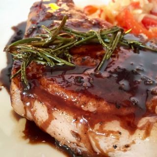 Pork chop with balsamic glaze.