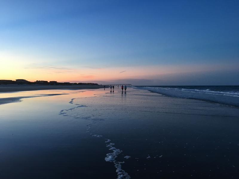 Walking on the beach at sunset.