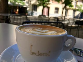 Checked in at Federal Café 2. Coffee — with Jessica