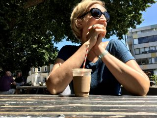 Having an iced latte in the sun.