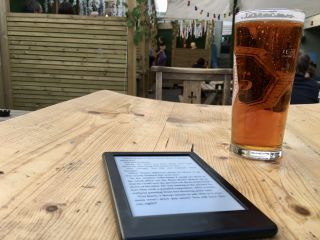 In a beer garden. With beer (and a book). 🍺 📖