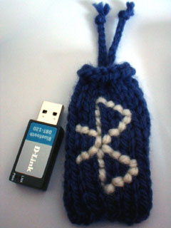 the Bluetooth dongle next to its cosy