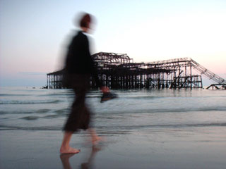 walking on the beach at low tide by the remains of the West Pier