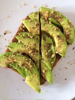 Eating toast (with avocado and dukkah).