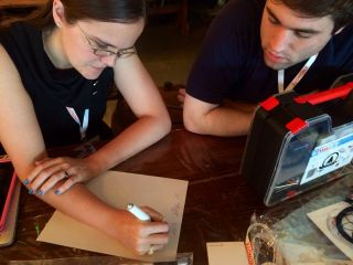 My science advisors @PlanetaryKeri and Nathan help figure out centrifugal force calculations for asteroid terraria.
