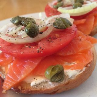 Irish smoked salmon, cream cheese, tomato, onion, and capers on a homemade bagel.