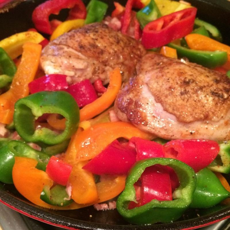 Cooking chicken on peppers.