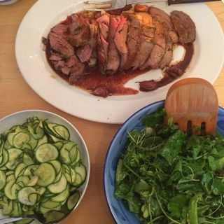 Lamb, courgettes, and salad.