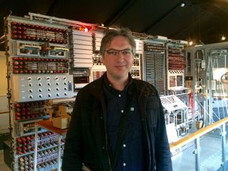 Standing before Colussus. This picture was taken with a miniaturised descendent of that machine.