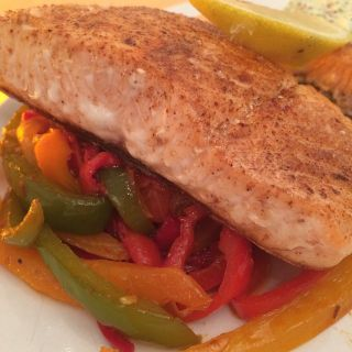Salmon on peppers.