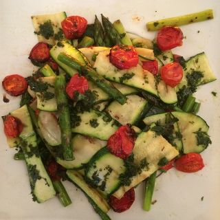 Griddled asparagus and courgette with roasted tomatoes and basil oil.