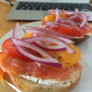 Smoked salmon, cream cheese, capers, onions and tomato on a homemade bagel.