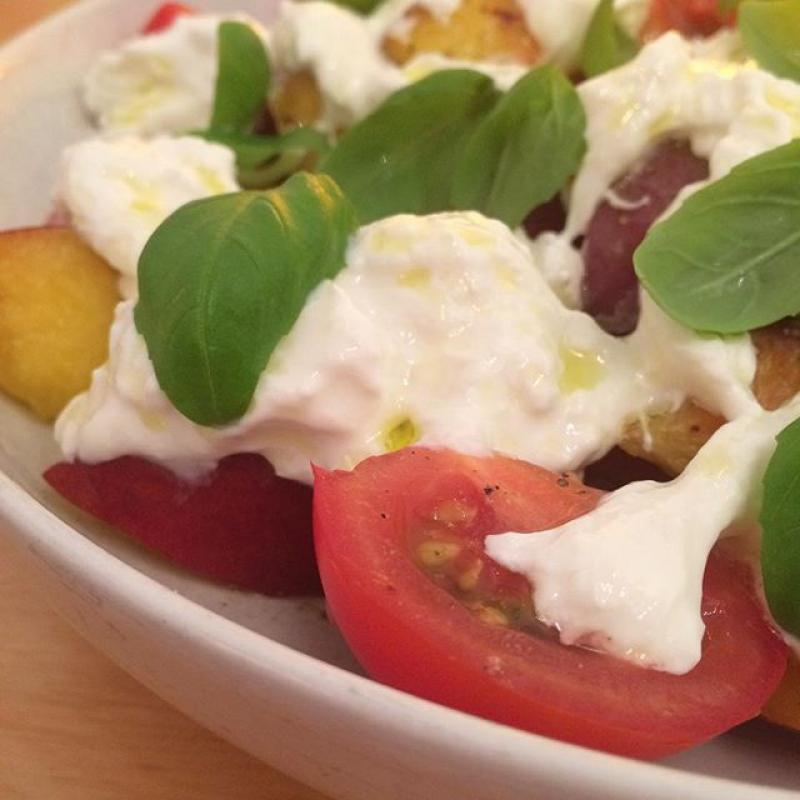 Tamatoes and peaches with burrata and basil.