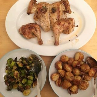 Roast spatchcocked chicken, Brussels sprouts, and roast potatoes.